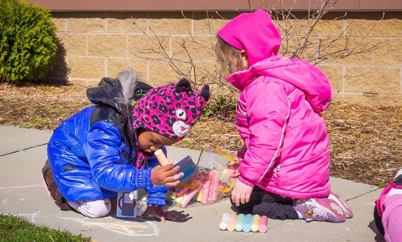 Children playing with sidewalk chalk2